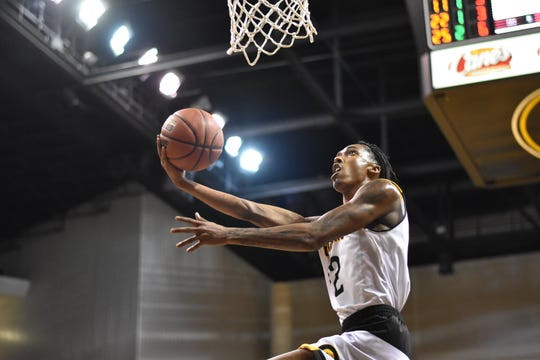 Grambling State redshirt sophmore guard Prince Moss (22) scored in a frenzy to help his team defeat Arkansas-Pine Bluff Saturday night at the Fredrick Hobdy Arena.