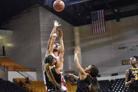 Grambling State senior point guard Shakyla HIll (2) puts up a floater against Arkansas-Pine Bluff the Fredrick Hobdy Arena Saturday.