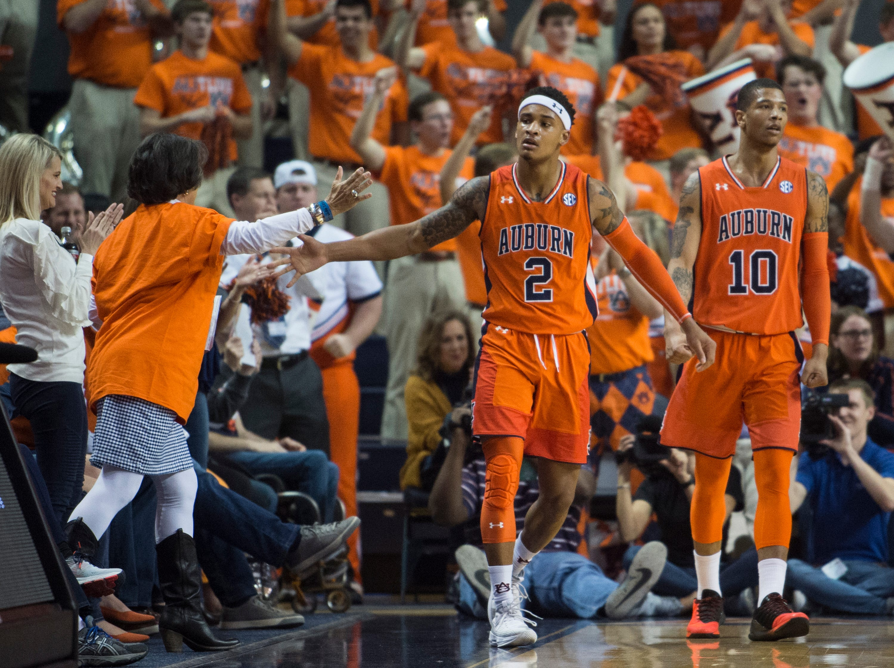 Auburn guard Bryce Brown (2) high fives a fan after making an and-one play at Auburn Arena in Auburn, Ala., on Saturday, Feb. 2, 2019. Auburn leads Alabama 48-28 at halftime.