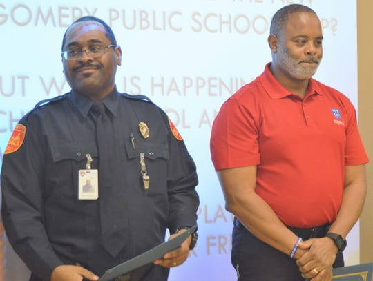 Jeff Davis High School security guard Antonio Hamilton, left, and MPACT Law and Public Safety instructor Curtis Daniels were recognized as the MPS Employees of the Month at the Montgomery County Board of Education meeting on Jan. 31, 2019.