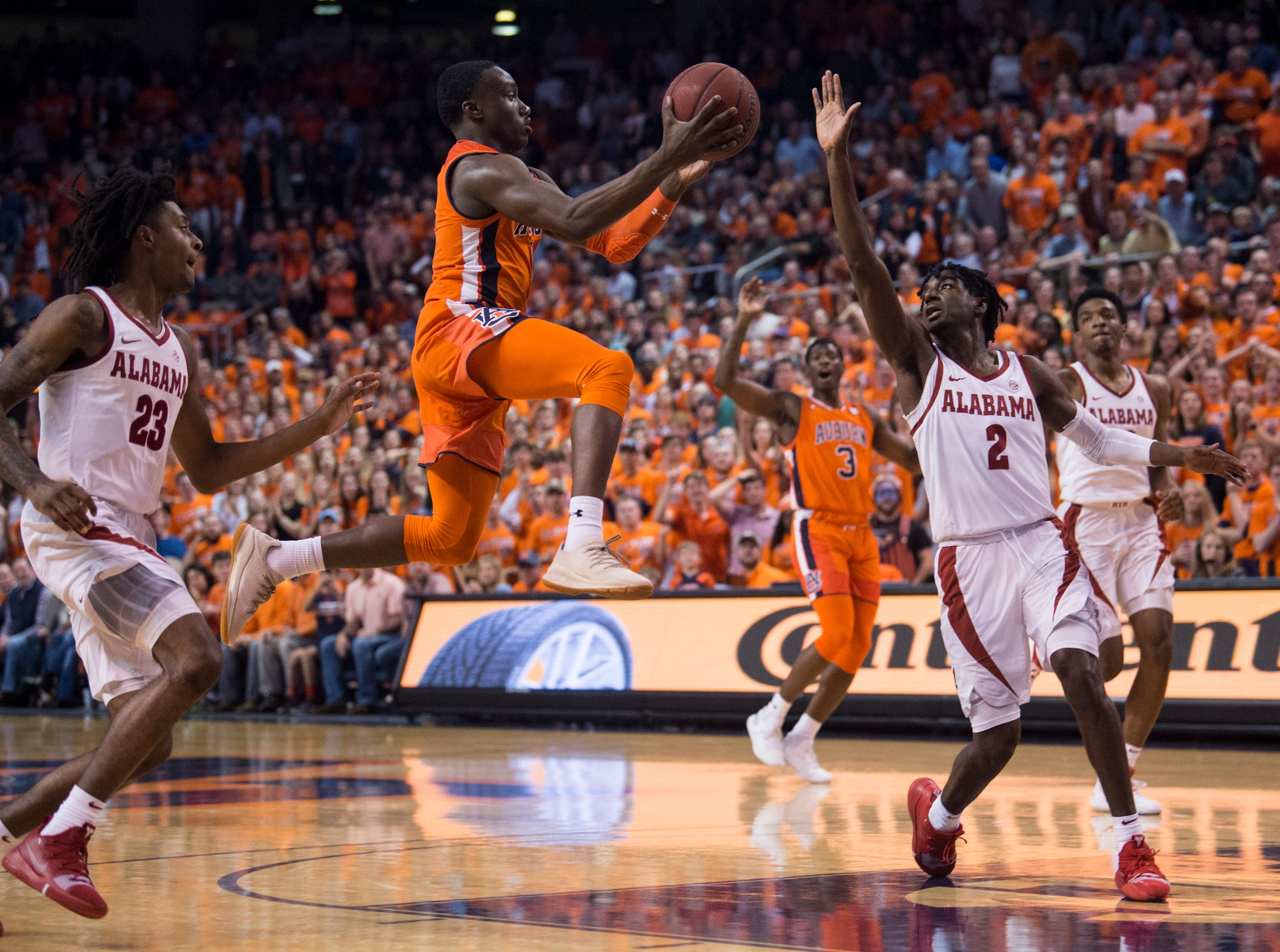 Auburn guard Jared Harper (1) makes a alley-op pass at Auburn Arena in Auburn, Ala., on Saturday, Feb. 2, 2019. Auburn leads Alabama 48-28 at halftime.