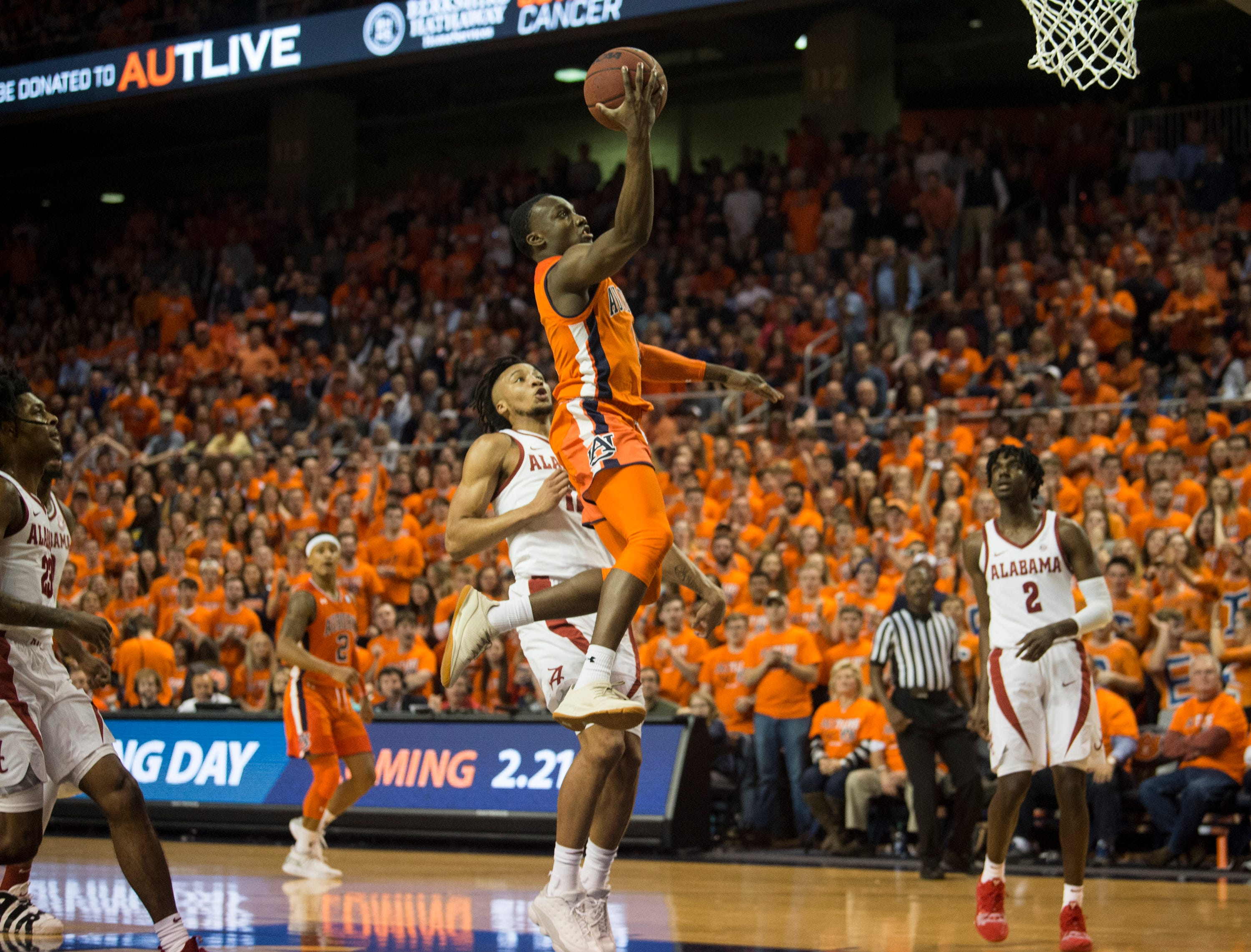 Auburn guard Jared Harper (1) goes up for a layup at Auburn Arena in Auburn, Ala., on Saturday, Feb. 2, 2019. Auburn leads Alabama 48-28 at halftime.