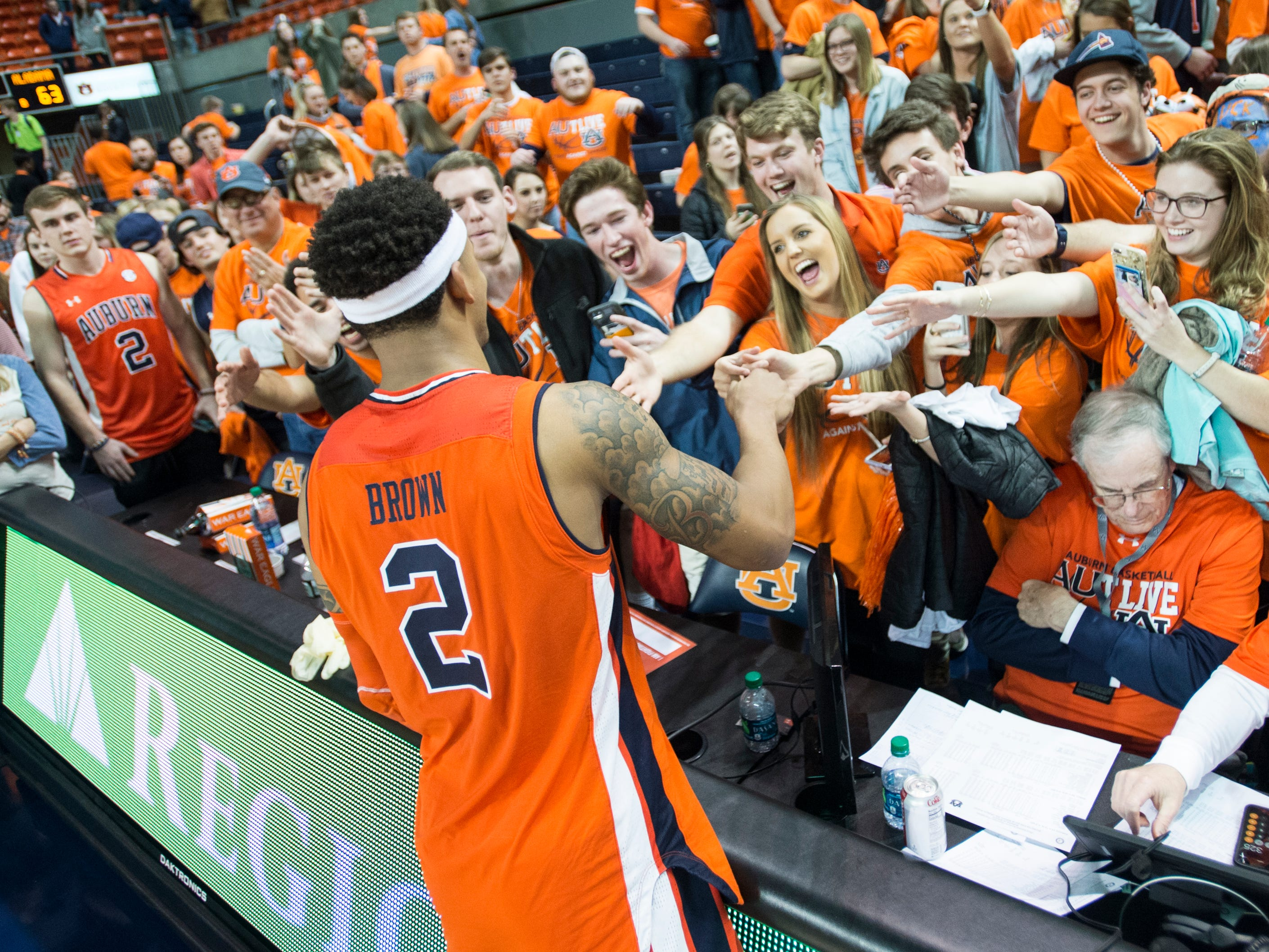 Auburn guard Bryce Brown (2) greets fans after the game at Auburn Arena in Auburn, Ala., on Saturday, Feb. 2, 2019. Auburn defeated Alabama 84-63.