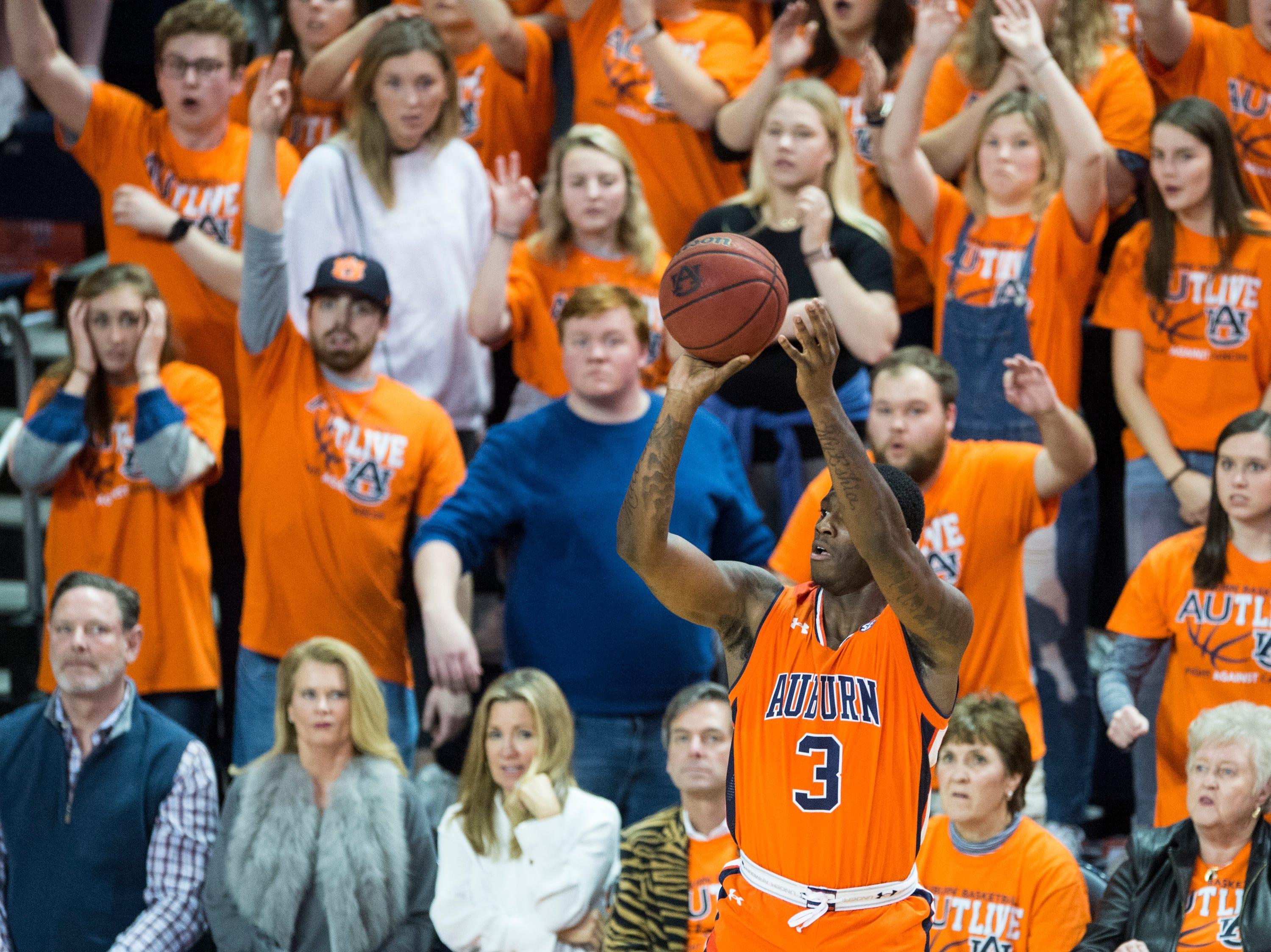 Auburn forward Danjel Purifoy (3) takes a three-pointer at Auburn Arena in Auburn, Ala., on Saturday, Feb. 2, 2019. Auburn defeated Alabama 84-63.