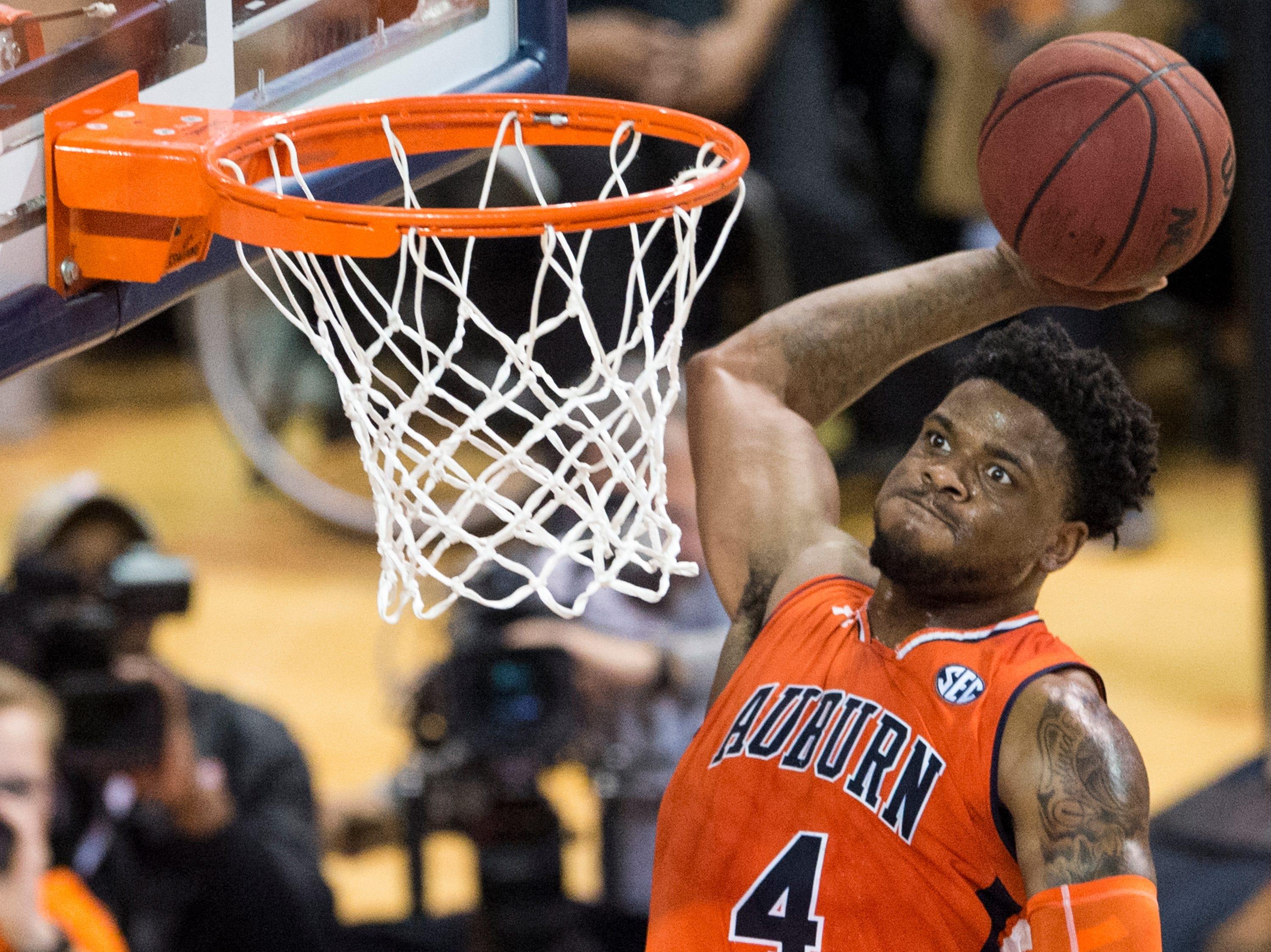 Auburn guard Malik Dunbar (4) dunks the ball at Auburn Arena in Auburn, Ala., on Saturday, Feb. 2, 2019. Auburn defeated Alabama 84-63.