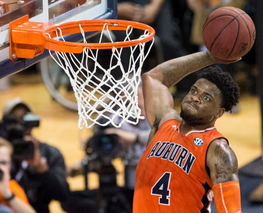 Auburn guard Malik Dunbar (4) dunks the ball at Auburn Arena in Auburn, Ala., on Saturday, Feb. 2, 2019. Auburn defeated Alabama 84-63.