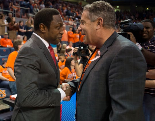 Alabama head coach Avery Johnson and Auburn head coach Bruce Pearl meet before the game at Auburn Arena in Auburn, Ala., on Saturday, Feb. 2, 2019. Auburn leads Alabama 48-28 at halftime.