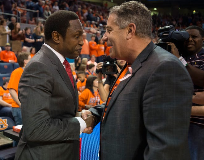 Alabama head coach Avery Johnson and Auburn head coach Bruce Pearl meet before the game at Auburn Arena in Auburn, Ala., on Saturday, Feb. 2, 2019. Auburn leads Alabama 48-28 at halftime.