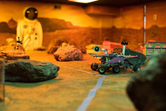 A student-made robot drives across a model of Mars' surface, Jan. 22, 2019, at STARBASE Maxwell. Whether they're making 3D models on the computer, learning how to find a culprit using fingerprints or programming their own robots to traverse across Mars, students attending STARBASE are fully immersed in the interactive, hands-on education experience.