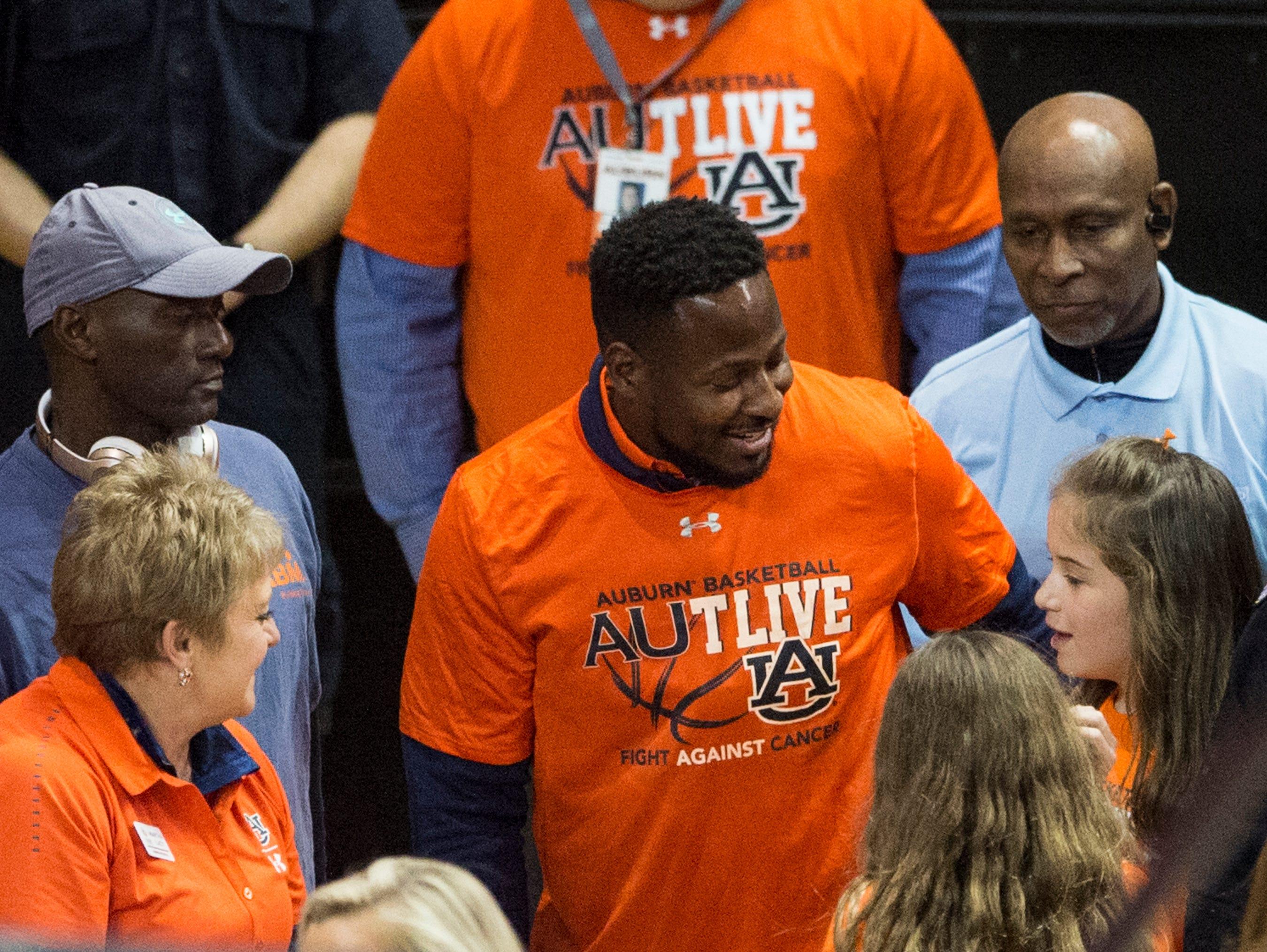 Auburn running back coach and former player Cadillac Williams greets fans at Auburn Arena in Auburn, Ala., on Saturday, Feb. 2, 2019. Auburn defeated Alabama 84-63.