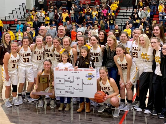 Monroe Central poses for photos after the Golden Bears defeated Lapel in the Sheridan Sectional championship game on Saturday.