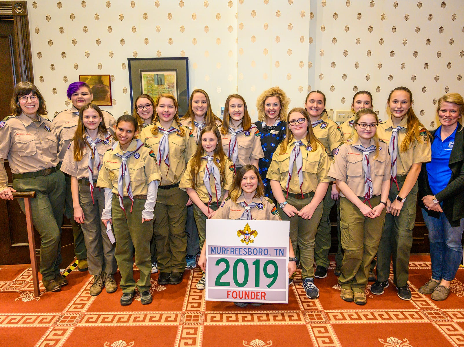 Members of Troop 2019 pose with Middle Tennessee State University employees after Friday's ceremony to welcome the new all-girl unit into Scouts BSA.