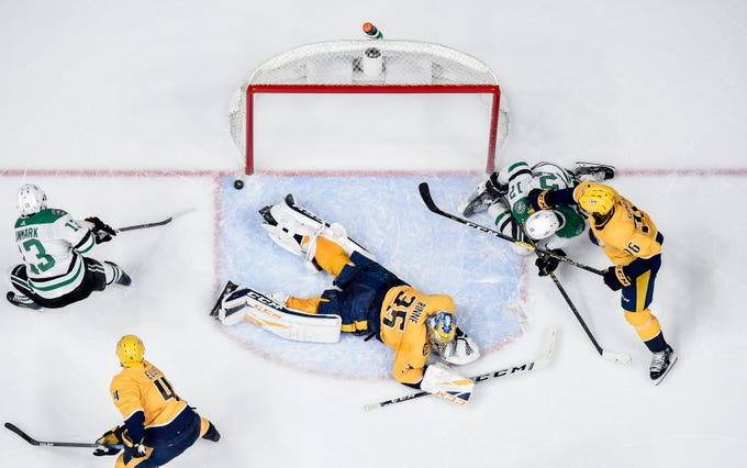 Dallas Stars center Mattias Janmark (13) scores past Nashville Predators goaltender Pekka Rinne (35) during the third period at Bridgestone Arena in Nashville, Tenn., Saturday, Feb. 2, 2019.
