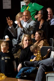 Vanderbilt athletics director Malcolm Turner talks to deputy athletics director Candice Storey Lee, right, while watching his first Commodores game against the Tennessee Lady Vols at Memorial Gym in Nashville, Tenn., on Sunday.