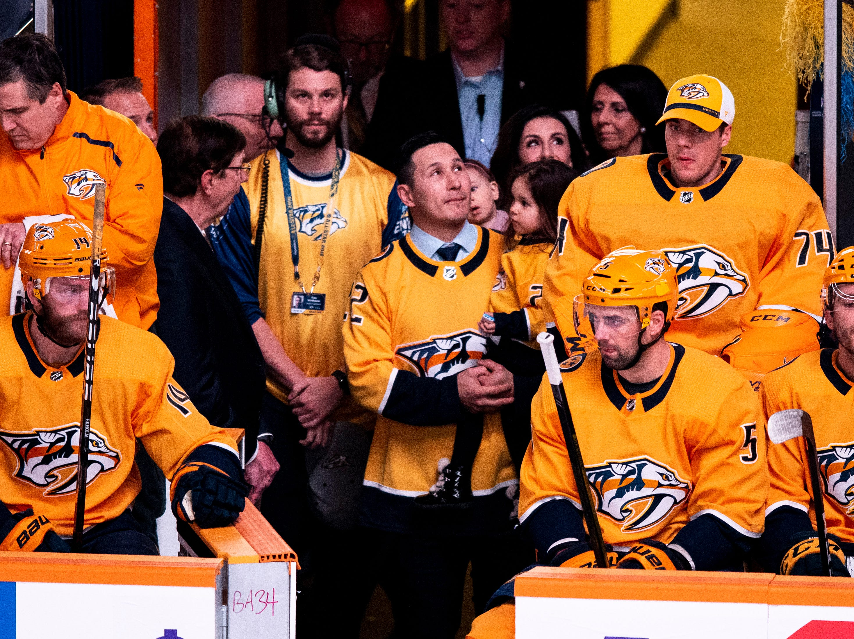 Former Nashville Predators forward Jordin Tootoo waits to be recognized before a game between the Nashville Predators and the Dallas Stars at Bridgestone Arena in Nashville, Tenn., Saturday, Feb. 2, 2019.