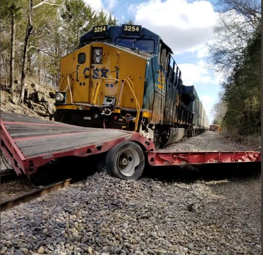 A train and tractor trailer collision closes roads in Williamson County as crews work to put the train's wheels back on the track. No injuries were reported.
