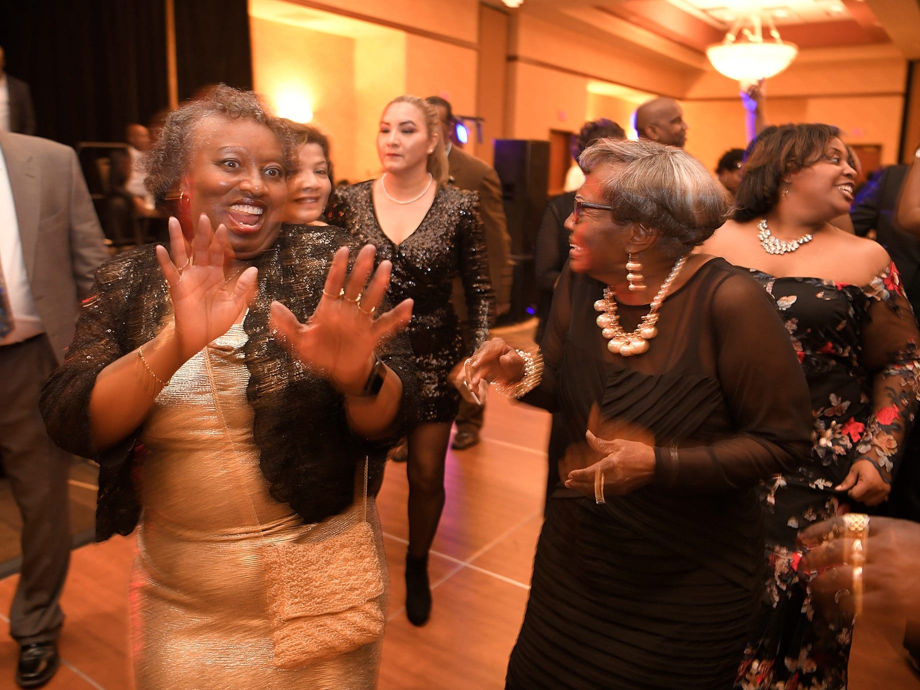 People dance at the African American Heritage Society=s 18th Annual Black Tie Affair at the Embassy Suites in Franklin on Sat., Feb. 2, 2019.