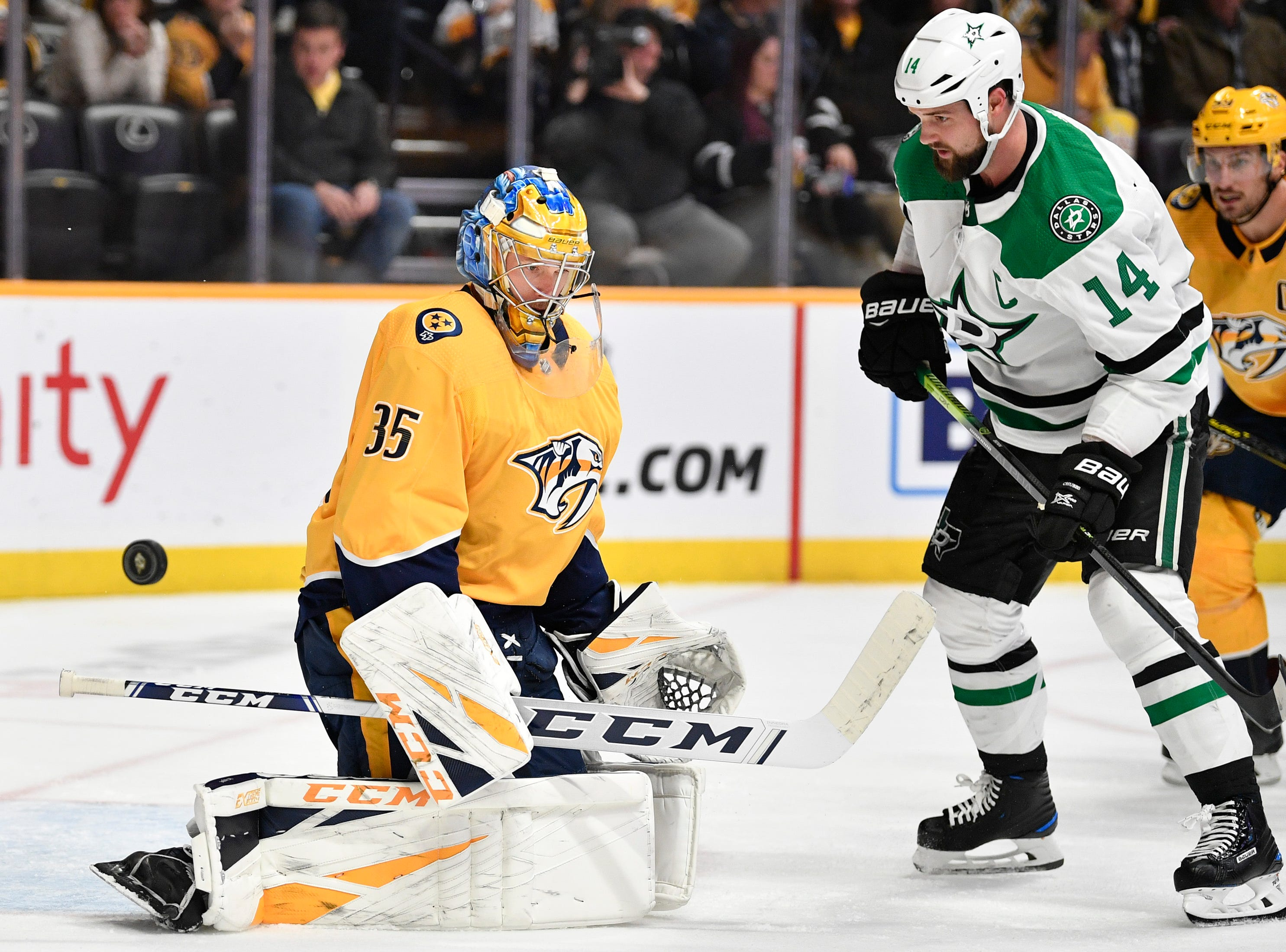 Nashville Predators goaltender Pekka Rinne (35) defends against Dallas Stars left wing Jamie Benn (14) during the second period at Bridgestone Arena in Nashville, Tenn., Saturday, Feb. 2, 2019.