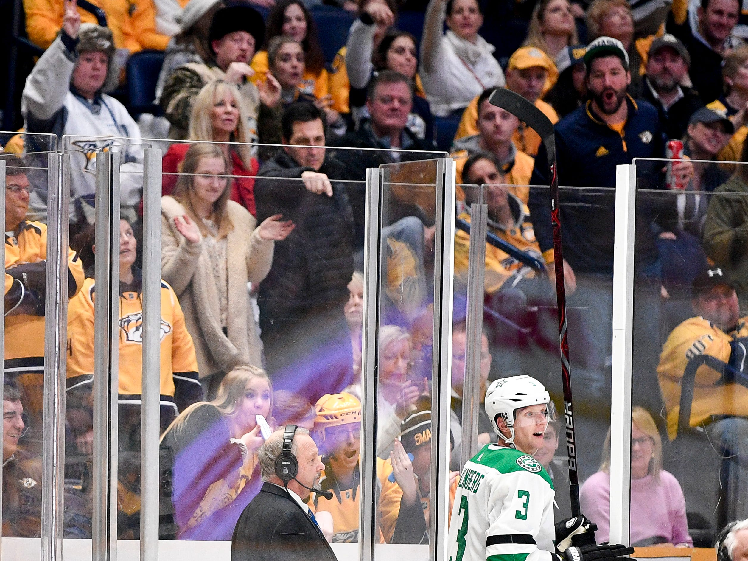 Nashville Predators fans taunt Dallas Stars defenseman John Klingberg (3) as he enters the penalty box for tripping during the third period at Bridgestone Arena in Nashville, Tenn., Saturday, Feb. 2, 2019.