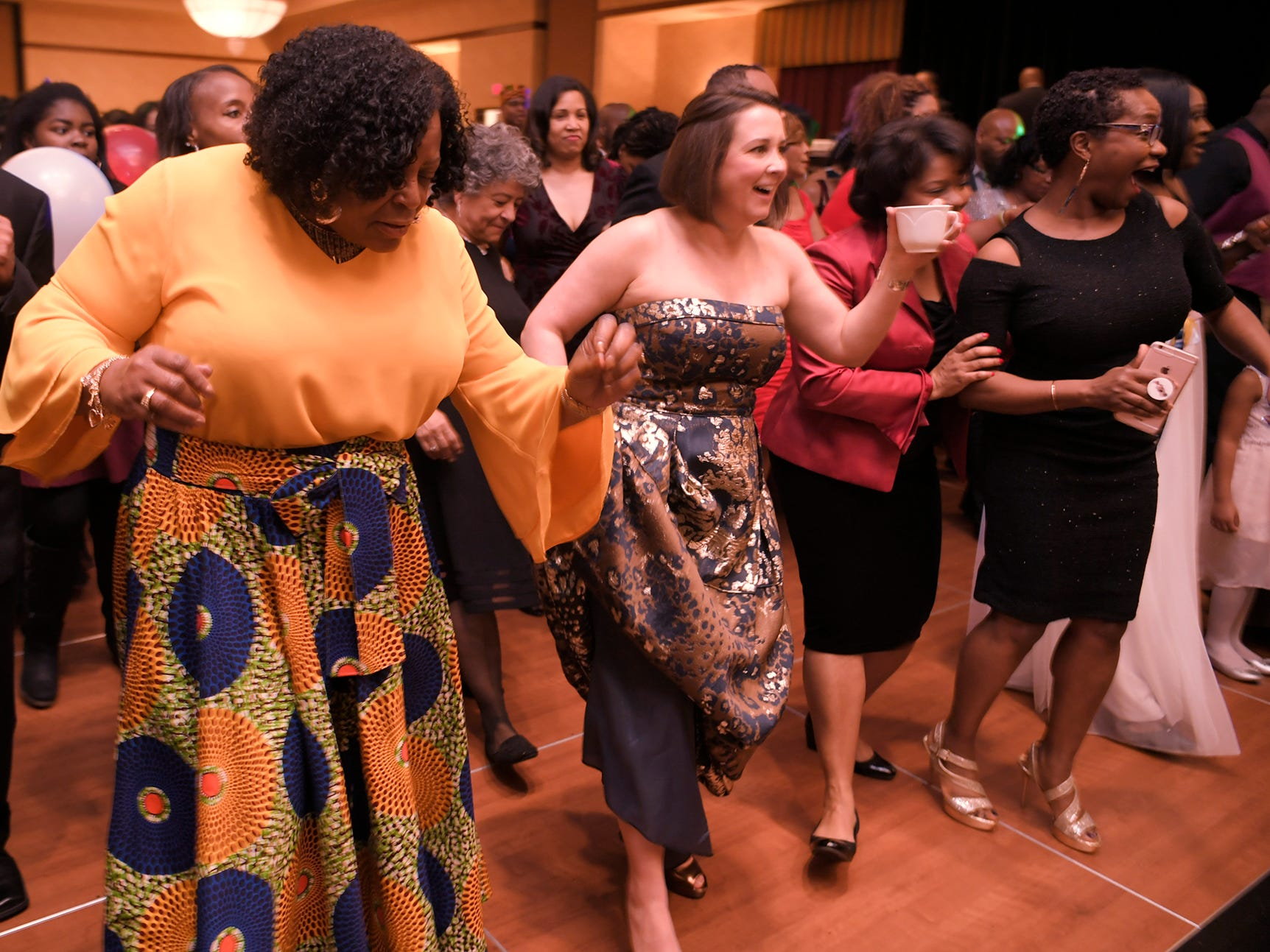 People line dance at the African American Heritage Society's 18th Annual Black Tie Affair at the Embassy Suites in Franklin on Sat., Feb. 2, 2019.