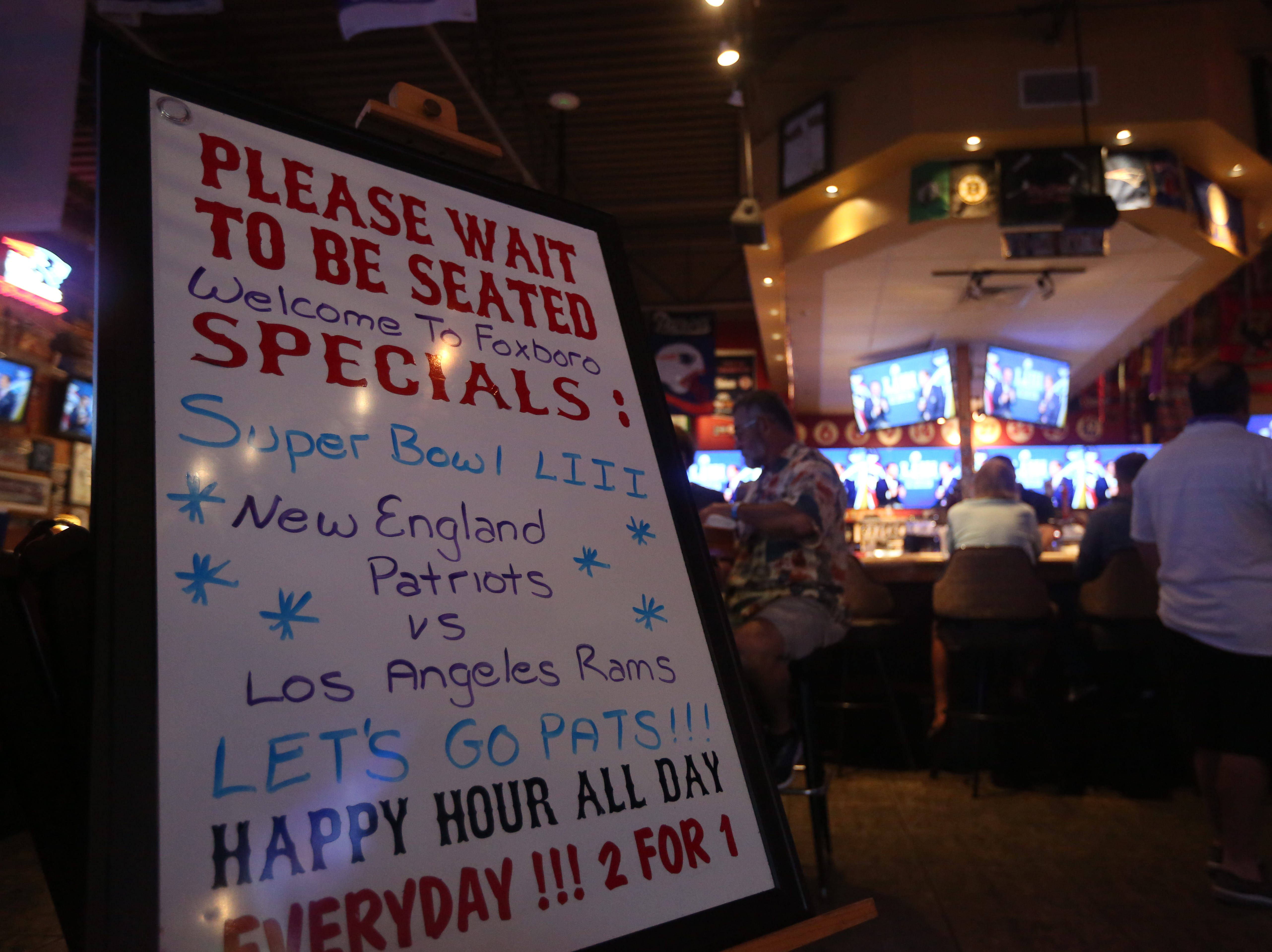 The Foxboro Sports Tavern in East Naples turns into an exclusive club for patrons who bought $35 tickets within days of the New England Patriots winning their final playoff game. Fans gathered for the game on Sunday, Feb. 3, 2019.