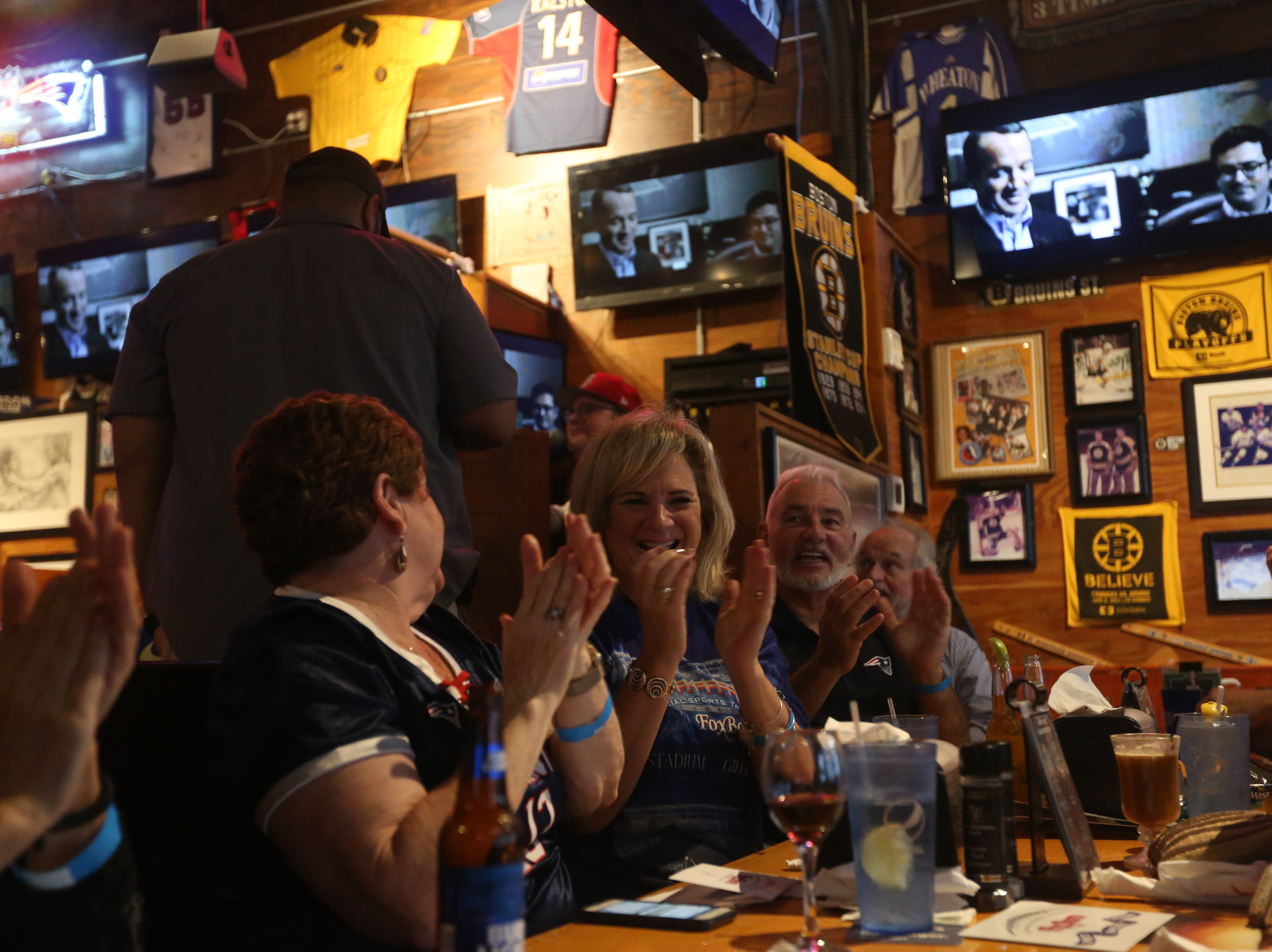 Monica Bradlee and Karen Kolozs, both of Naples, cheer on the New England Patriots at the Foxboro Sports Tavern in East Naples on Sunday, Feb. 3, 2019.