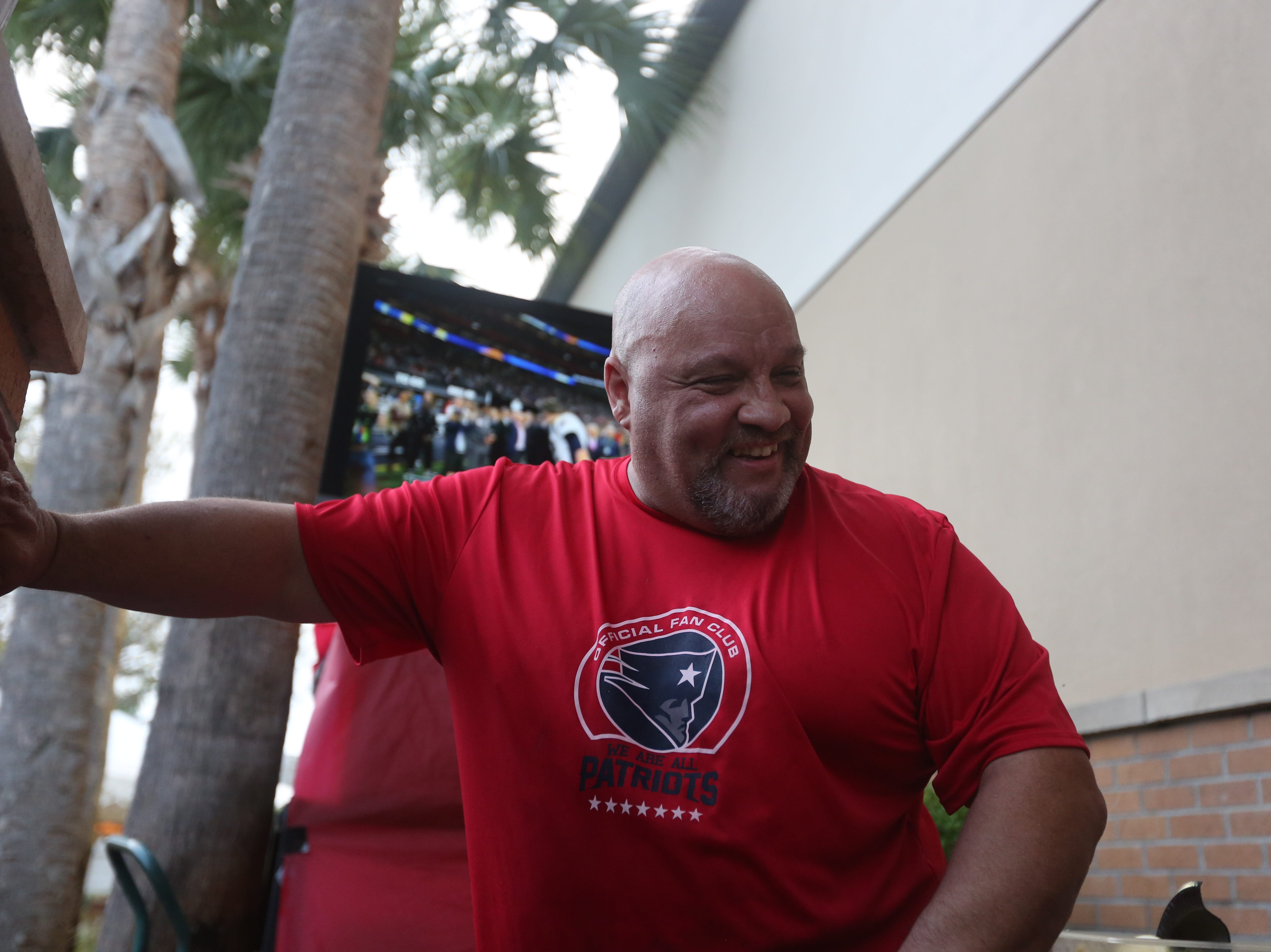 """""""Handsome Joe"""" Carkin, manager at Foxboro Sports Tavern in East Naples, helps at the outdoor bar during the Super Bowl on Sunday,  Feb. 3, 2019"""