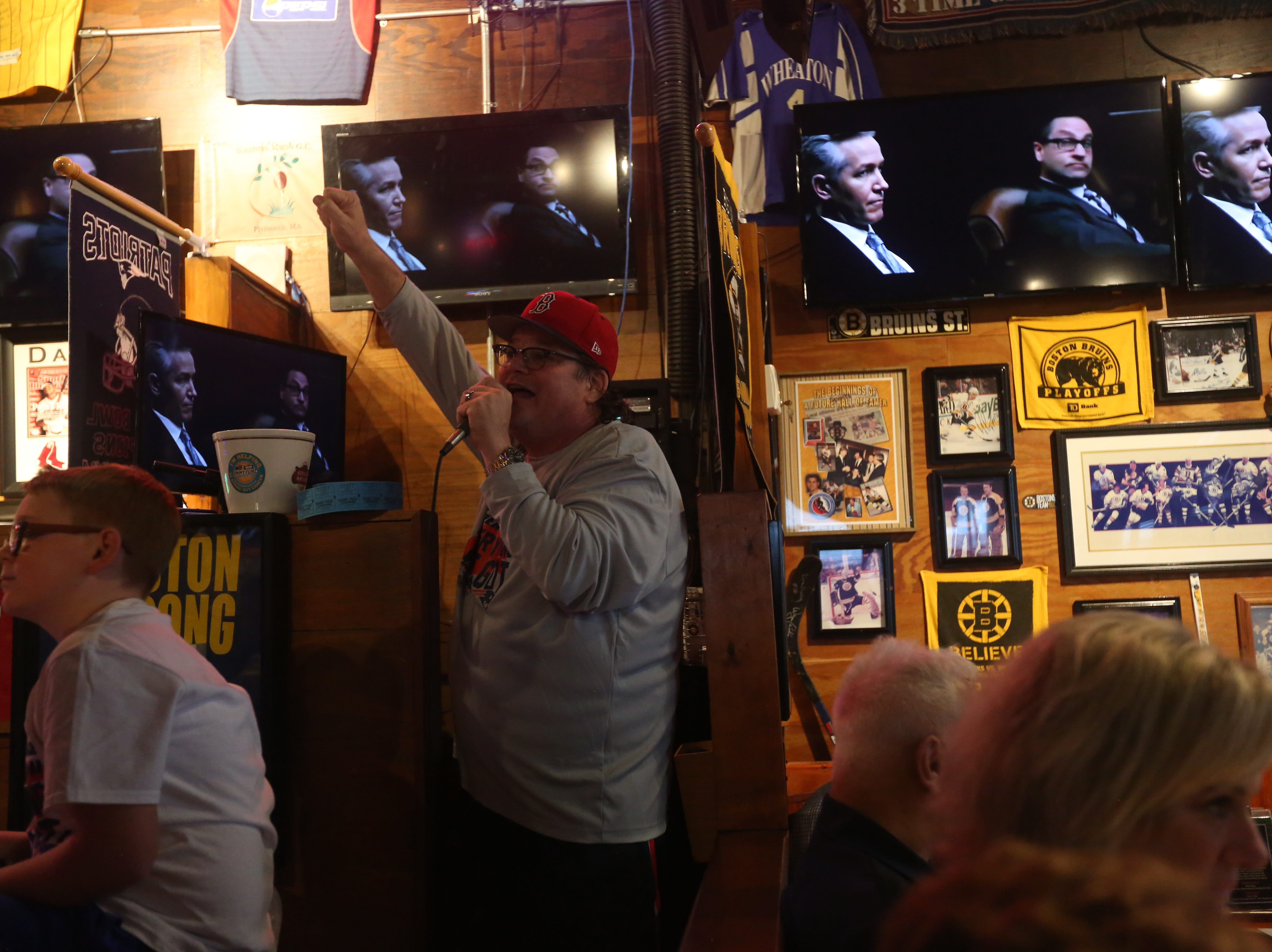 Foxboro Sports Tavern owner Thom Popoli takes to the microphone, offering his own commentary during the Super Bowl in East Naples on Sunday, Feb. 3, 2019.