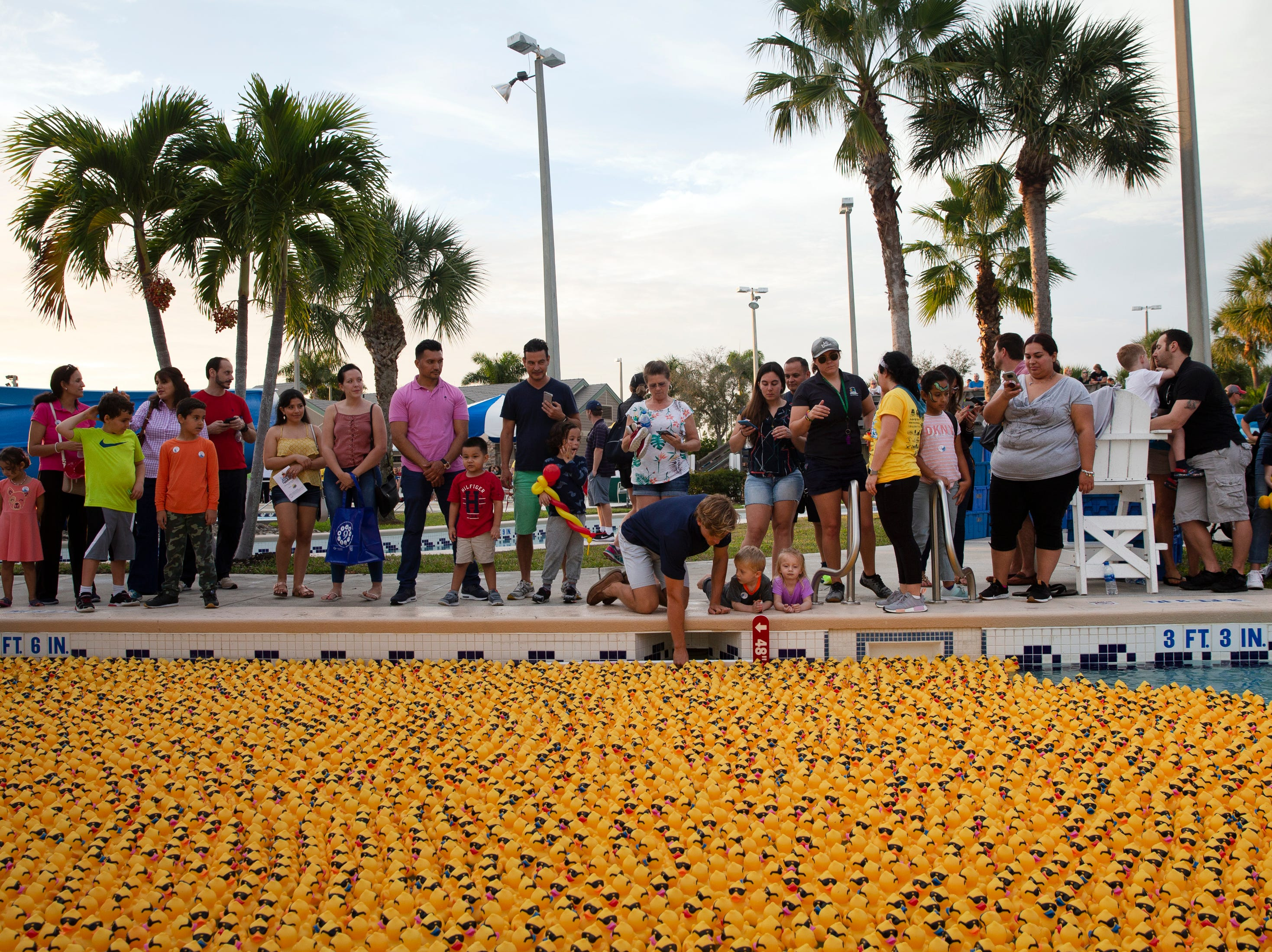 Community member wait for the start of the Great Naples Rubber Duck Race on Saturday, Feb. 2, 2019, in East Naples.