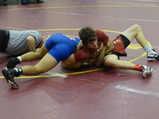 Licking Heights sophomore Ryan Wand wrestles Zanesville's Issac Payton in a 138-pound match last Saturday during the Hornet Invitational.