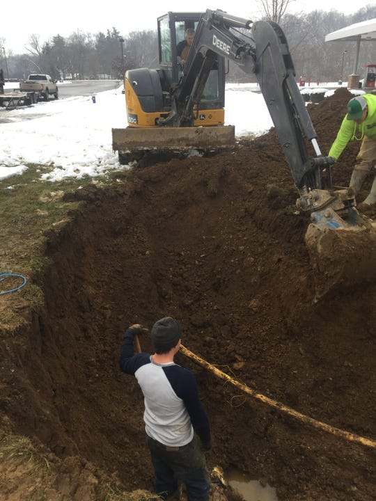 Crews work on a water line near Cherry Valley road Sunday morning.