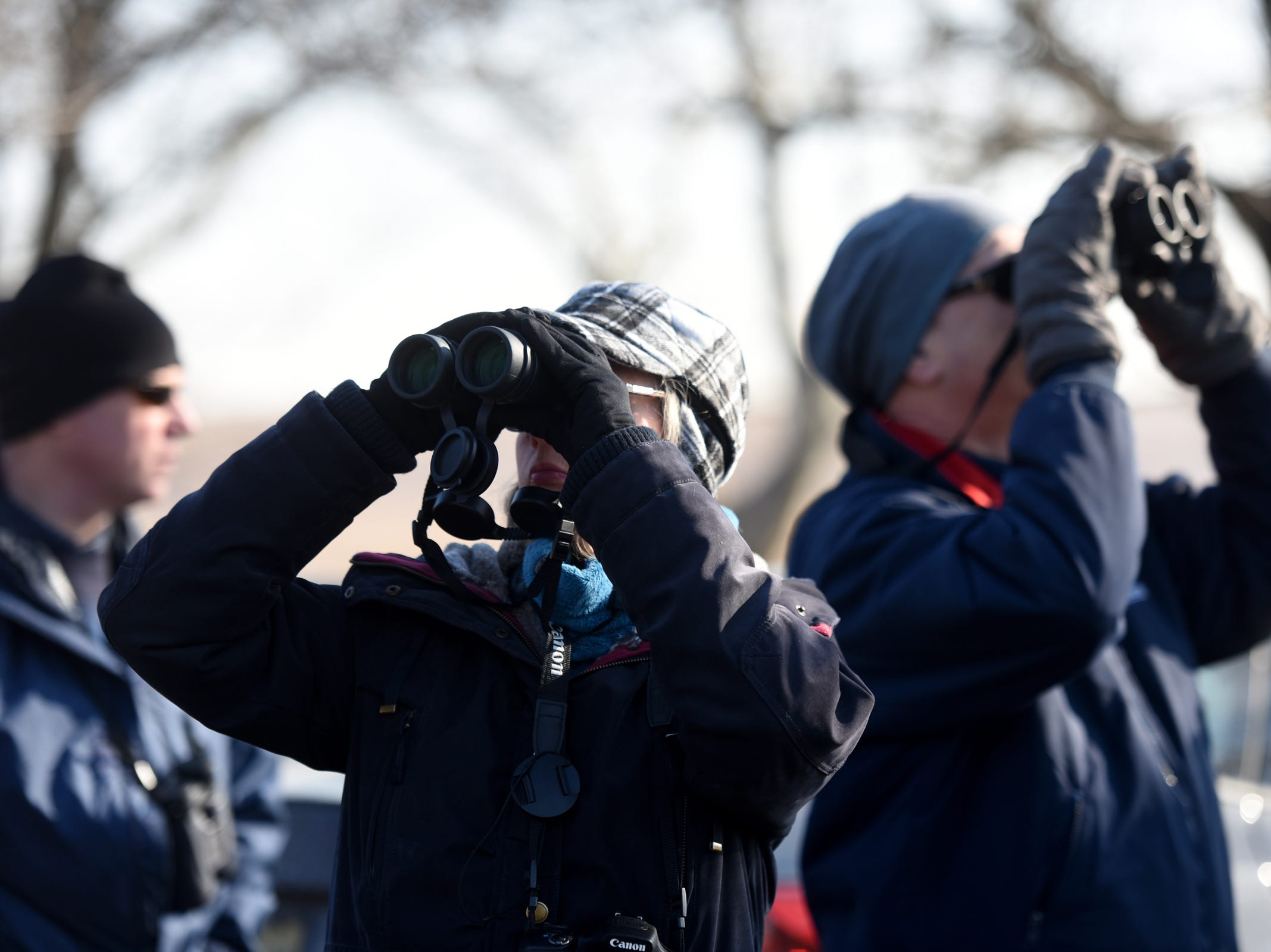 Lynn McKenzie of Ramsey and David Kleiner of Bloomfield use their binoculars to search for birds during a wintering birds and nature walk hosted by the Bergen County Audubon Society at Dekorte Park in Lyndhurst on Sunday, February 3, 2019.