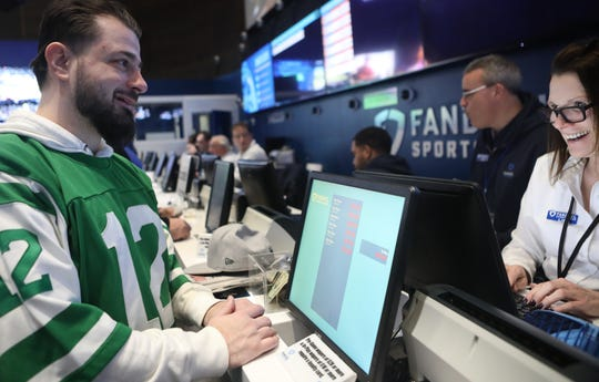 Brian Leavy, of Queens, places a bet with Lisa T. of FanDuel, in East Rutherford. Sunday, February 3, 2019