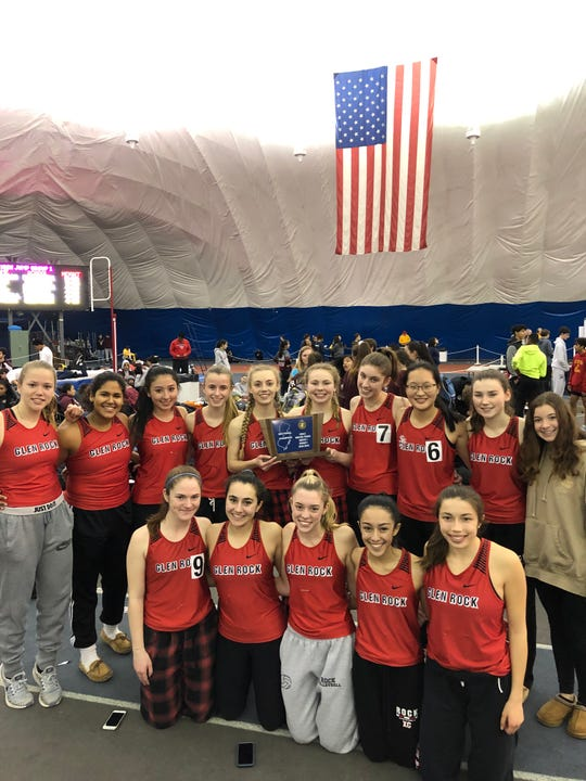 Glen Rock girls indoor track team showing off their North 1, Group 1 sectional trophy after rallying to edge Hasbrouck Heights and Mountain Lakes at the Bennett Center in Toms River on Friday, Feb. 1, 2019.