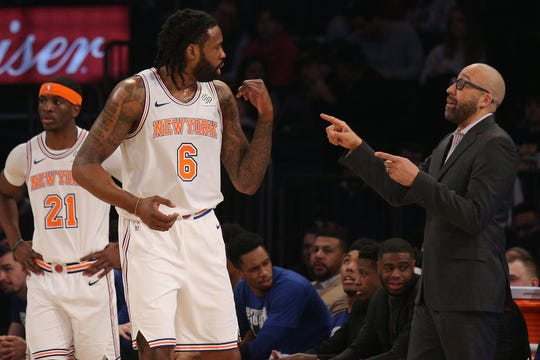 New York Knicks head coach David Fizdale (right) talks to Knicks center DeAndre Jordan (6) during the first quarter against the Memphis Grizzlies at Madison Square Garden.