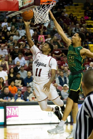 New Mexico State's Keyon Jones goes underneath for a lay up against Chicago State on Saturday at the Pan American Center.
