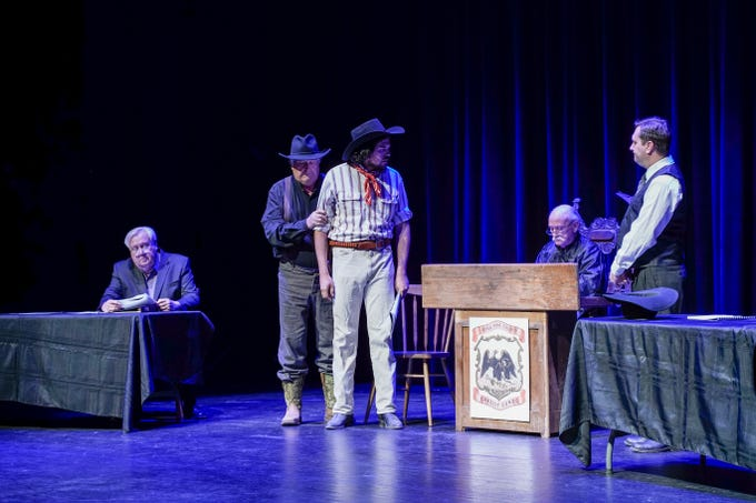 Actors reenact the 1909 trial of Jesse Wayne Brazel, the alleged murderer of Pat Garrett, at the Rio Grande Theatre on Saturday, Feb. 2, 2019. From left, John Wood, portraying New Mexico Attorney General James Hervey; Rick Eldridge playing the bailiff; Mozart Pierson playing Jesse Wayne Brazel; Bob Gamboa playing Presiding Justice of the Peace Manuel Lopez; and Jason Wyatt as Brazel's counsel Herbert Holt.