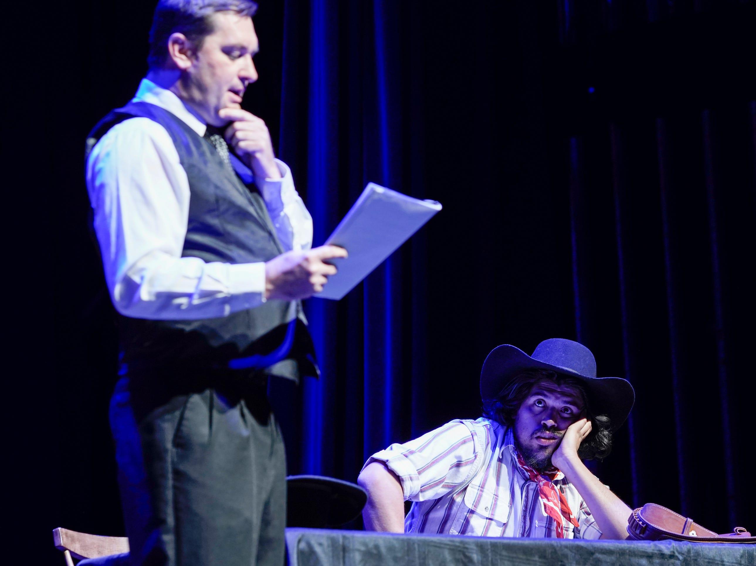 Jason Wyatt, left, portraying Jesse Wayne Brazel's counsel, Herbert Holt, and Mozart Pierson, as Brazel, reenact Brazel's 1909 murder trial at the Rio Grande Theatre on Saturday, Feb. 2, 2019.