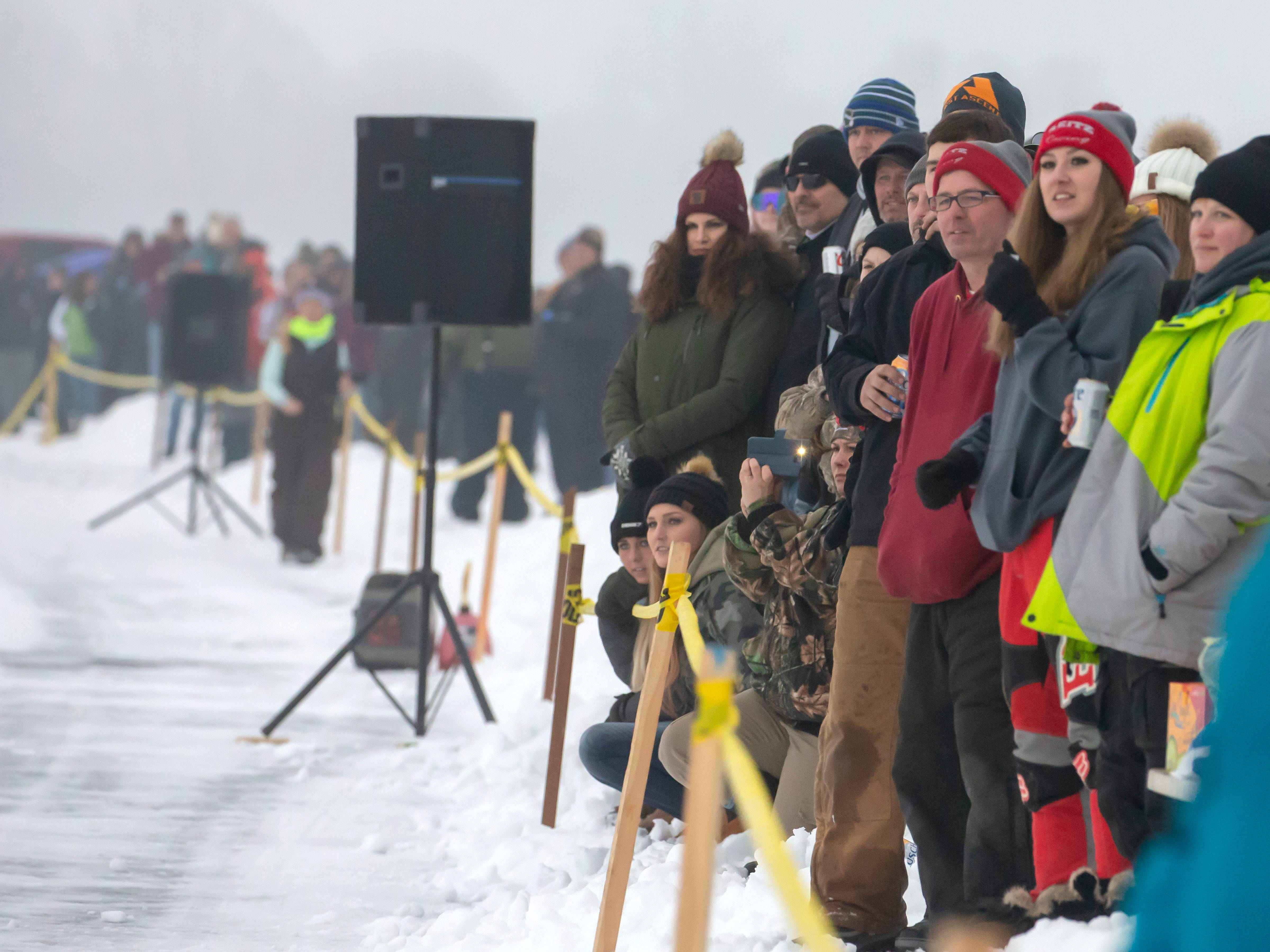 A crowd watches the races held during the Otter Street Fishing Club Winter Fisheree at Miller's Bay in Menominee Park on Saturday, Feb. 2, 2019.