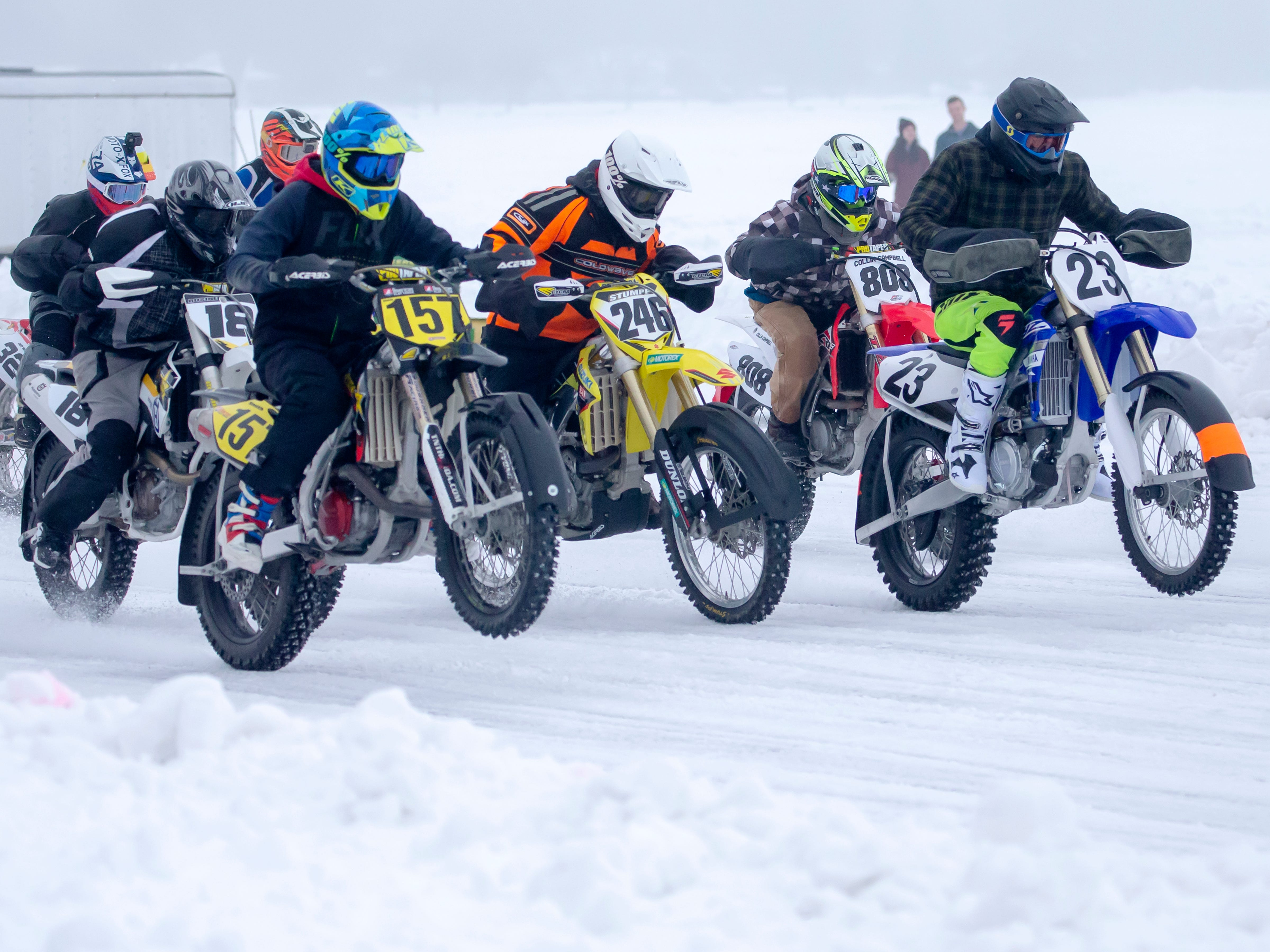 Jake Drummond (23) and other racers take off from the starting line racing during the Otter Street Fishing Club Winter Fisheree at Miller's Bay in Menominee Park on Saturday, Feb. 2, 2019.