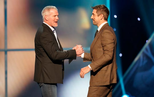 IMAGE DISTRIBUTED FOR THE NFL - Former NFL player Brett Favre, left, presents the moment of the year award to Aaron Rodgers of the Green Bay Packers at the 8th Annual NFL Honors at The Fox Theatre on Saturday, Feb. 2, 2019, in Atlanta. (Photo by Paul Abell/Invision for NFL/AP Images)