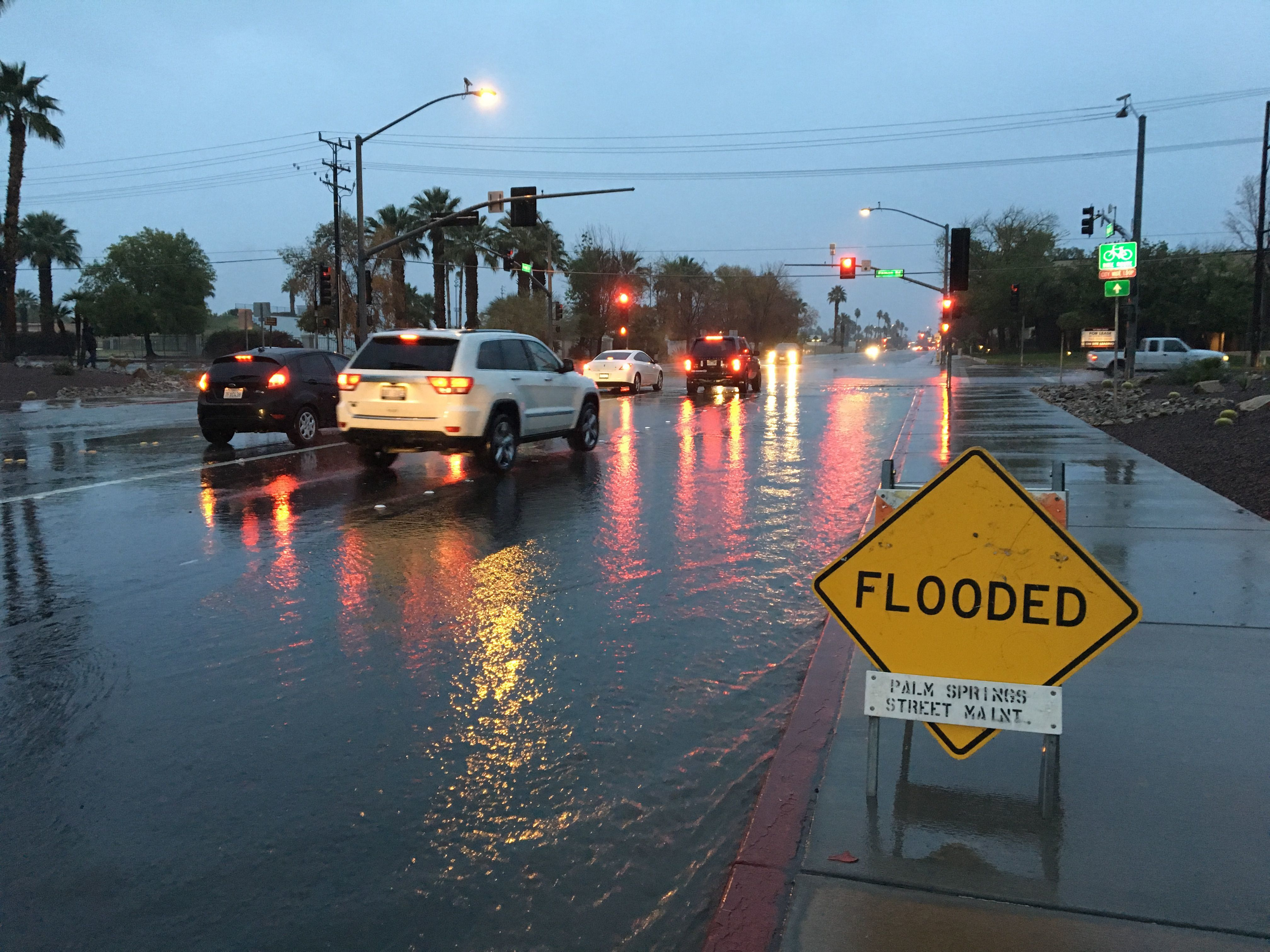 A sign warns drivers of flooding at Farrell Drive and Ramon Road in Palm Springs in this Desert Sun file photo.