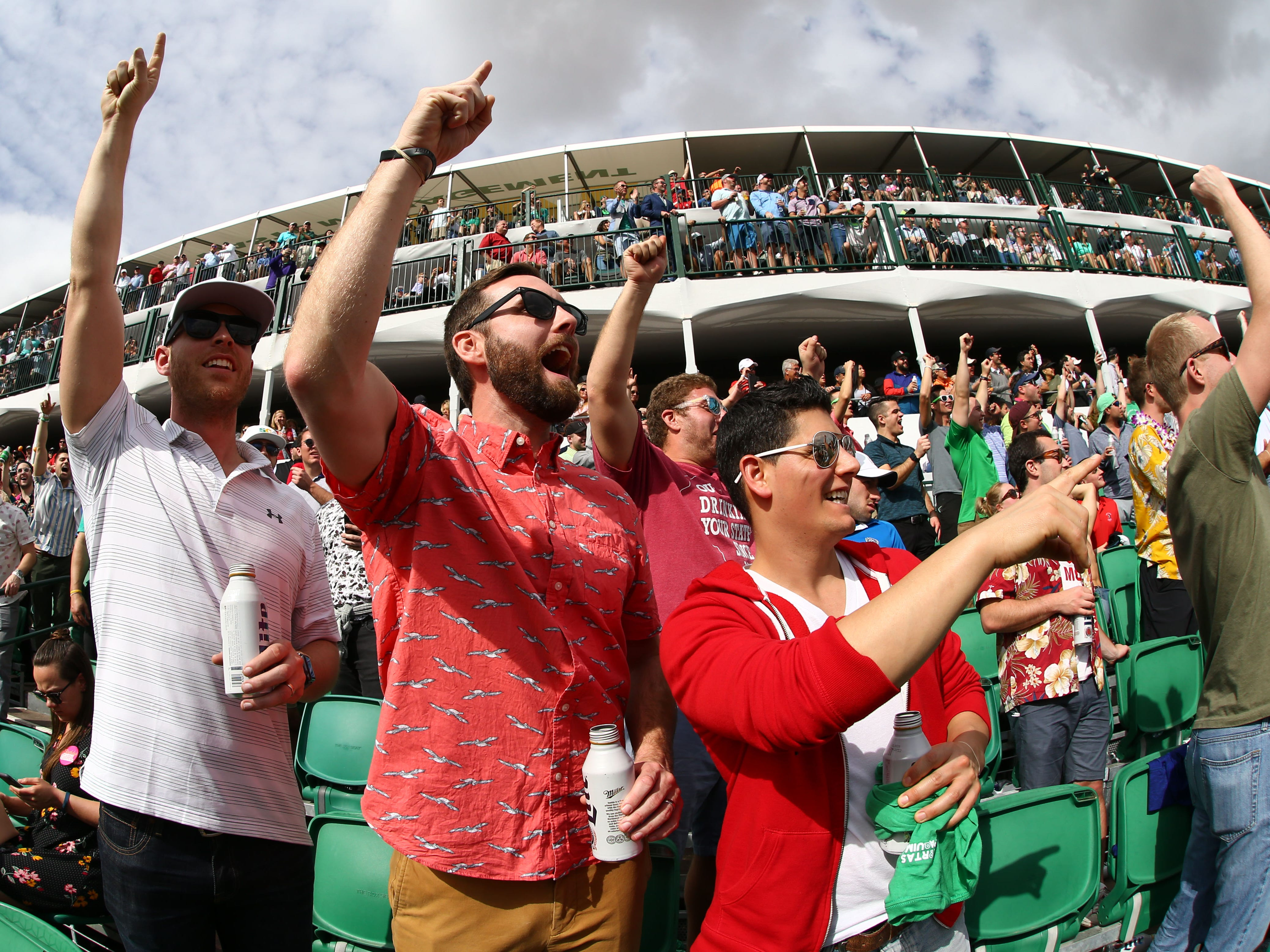 Fans cheer on the 16th hole during third round action on Feb. 2 during the Waste Management Phoenix Open at the TPC Scottsdale Stadium Course.