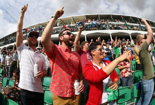 Fans cheer on the 16th hole during the Waste Management Phoenix Open 2019 at the TPC Scottsdale Stadium Course.
