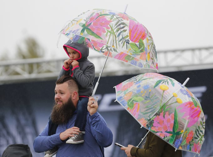 John Ollila holds Gavin, 5, while watching the final round of the Waste Management Phoenix Open at the TPC Scottsdale Feb. 3, 2019. They are visiting from Dunbar, Wisconsin.