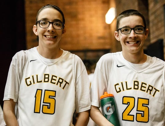 Gilbert basketball managers Isaac and Marcus MacDonald balled out in Friday night's win over Higley.