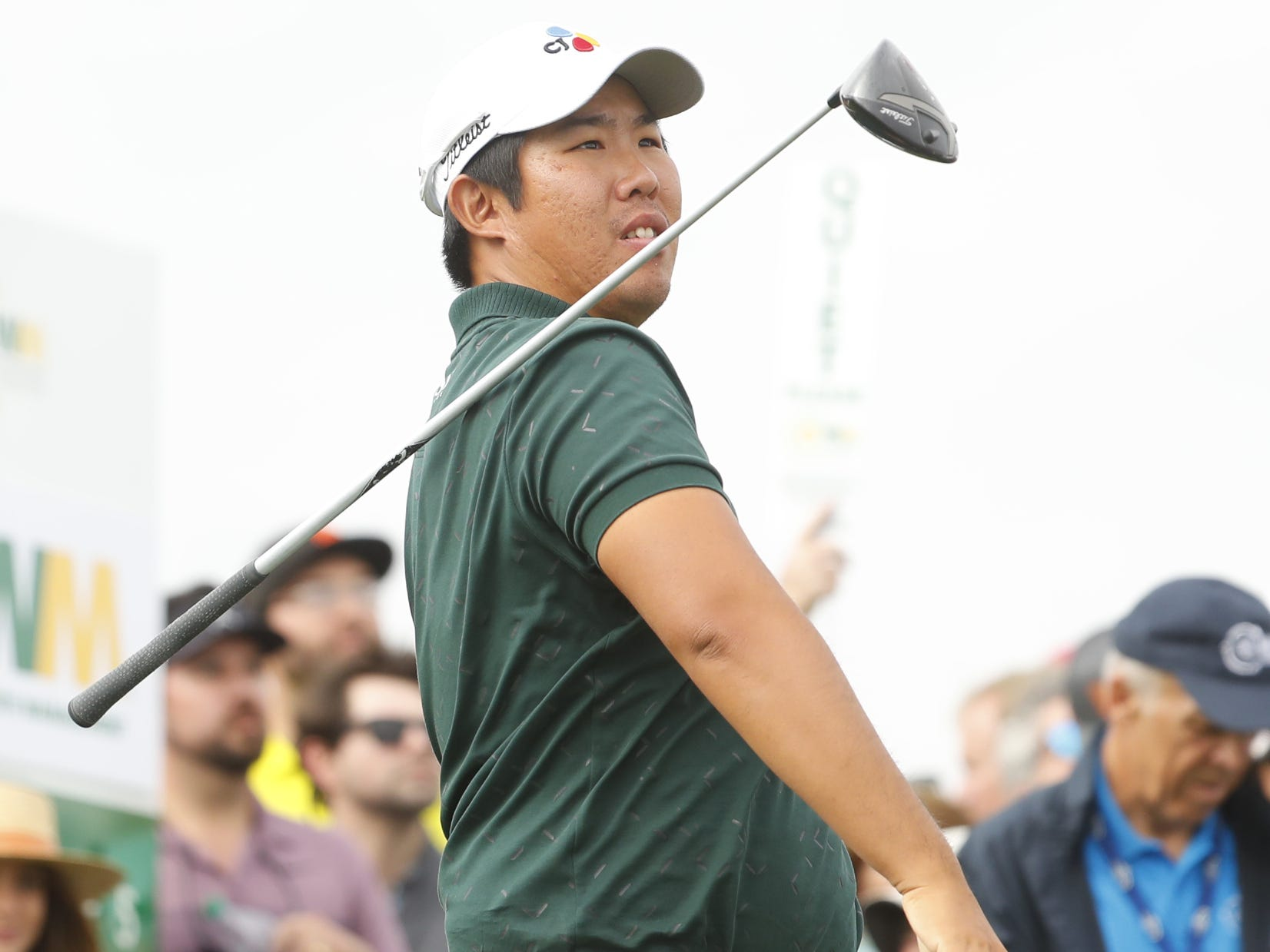 Byeong Hun An releases his club after hitting a tee shot on the 15th hole during the third round of the Waste Management Phoenix Open at TPC Scottsdale in Scottsdale, Ariz. on February 2, 2019.