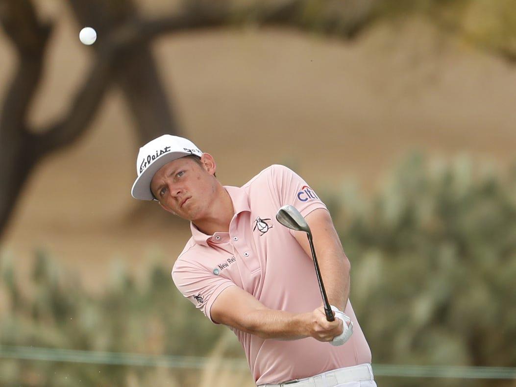 Cameron Smith hits a shot from the bunker on the 14th hole during the third round of the Waste Management Phoenix Open at TPC Scottsdale in Scottsdale, Ariz. on February 2, 2019.