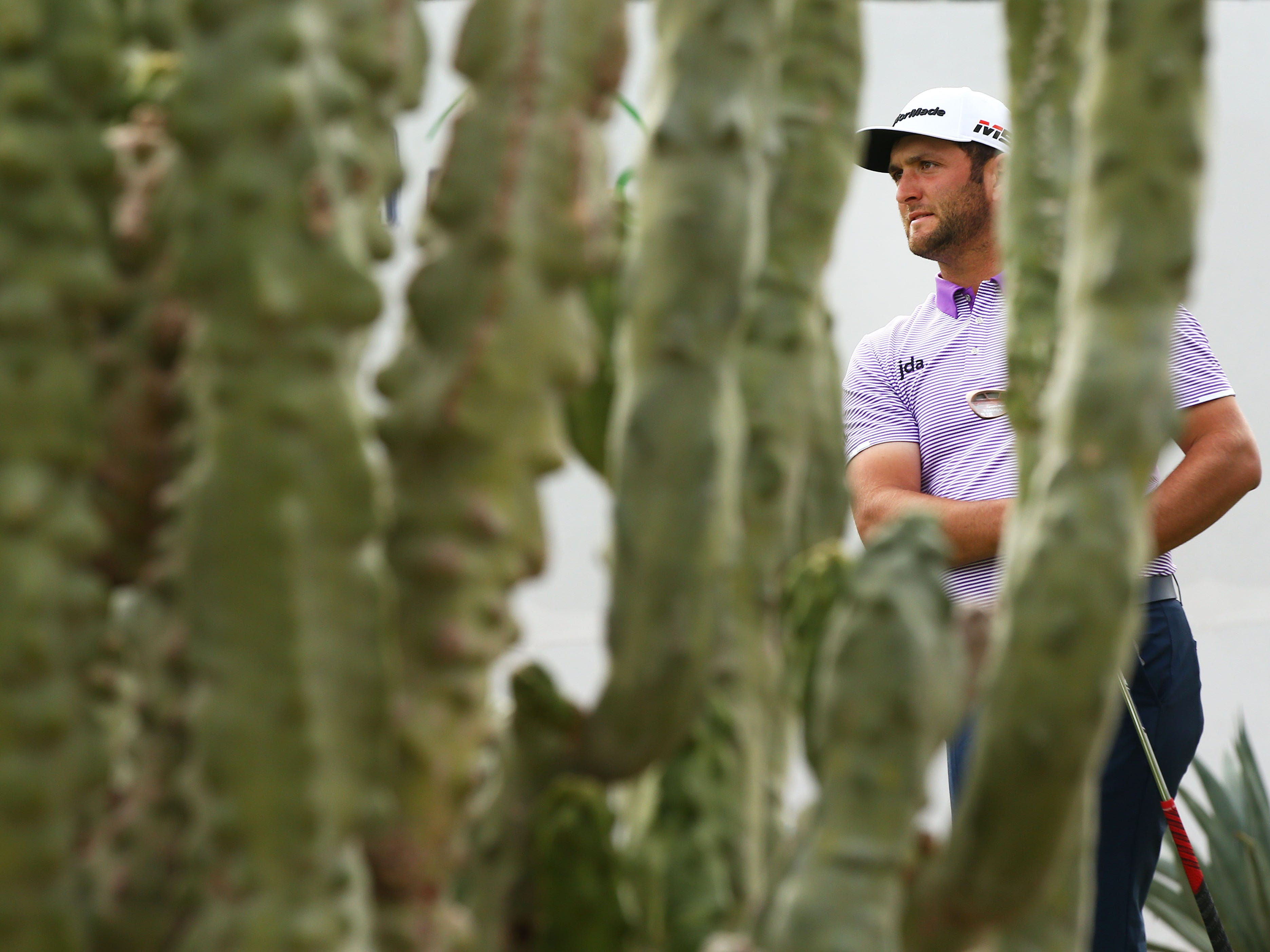 Jon Rahm watches his tee shot on the 16th hole during third round action on Feb. 2 during the Waste Management Phoenix Open at the TPC Scottsdale Stadium Course.
