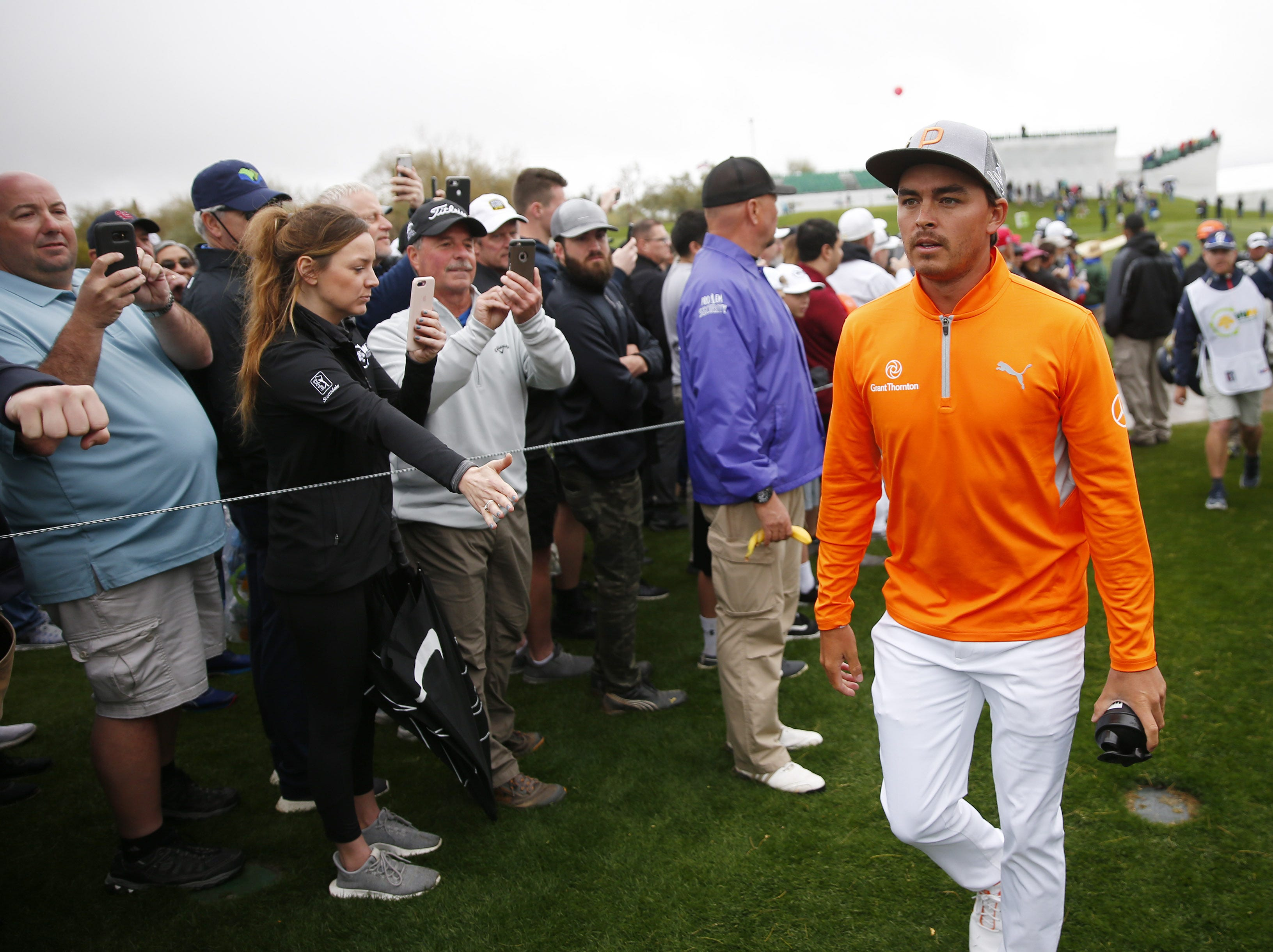 Rickie Fowler walks to the third tee during the final round of the Waste Management Phoenix Open at the TPC Scottsdale Feb. 3, 2019.